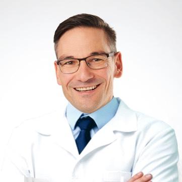 Dr. Genée